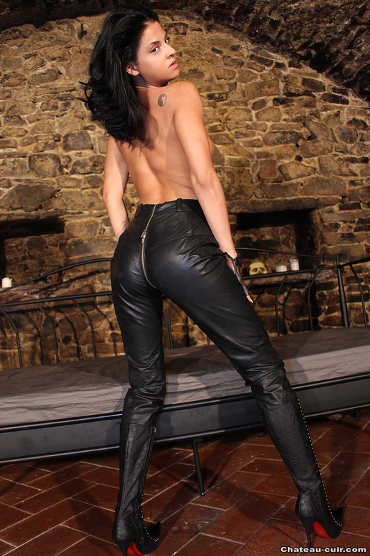 Woman Wearing Black Leather Bdsm Clothes Pants And Belt Stock Image